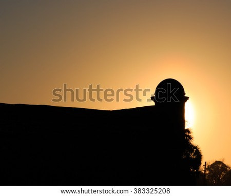 Spanish fort in silhouette in St Augustine, FL - stock photo