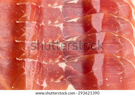 Spanish jamon, dry-cured ham thin slicing for background. Top view - stock photo
