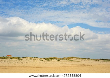 Spanish landscape with sand and sky with clouds. Small house on horizon. - stock photo