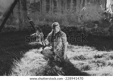 Spanish military girl with his machine gun. Photographs in black and white - stock photo