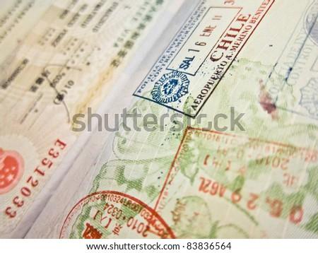 Spanish passport flying to Chile - stock photo