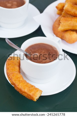 spanish pastry - cup of chocolate with churros - stock photo
