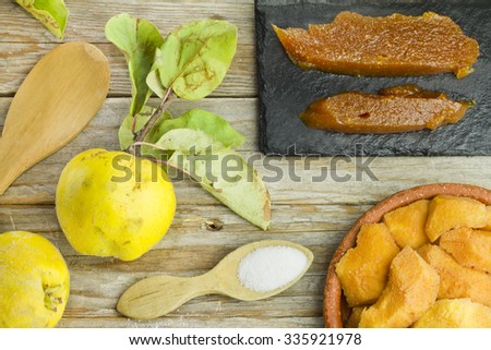 Spanish quince paste with ingredients recipe with ingredients on wooden background - stock photo