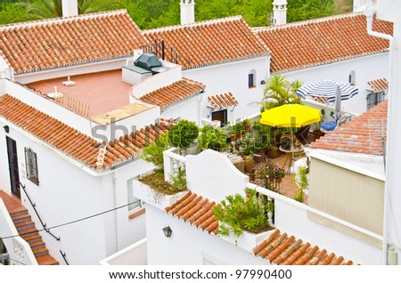Spanish rooftop terraces on the Mediterranean coast in Malaga region, Spain - stock photo