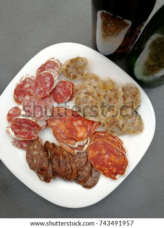 Spanish sausages and appetizer olives