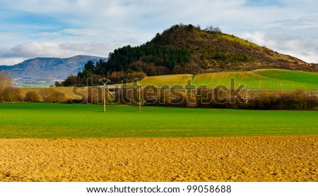 Spanish Spring Fields and Railroad on the Background of Peaks of the Pyrenees - stock photo