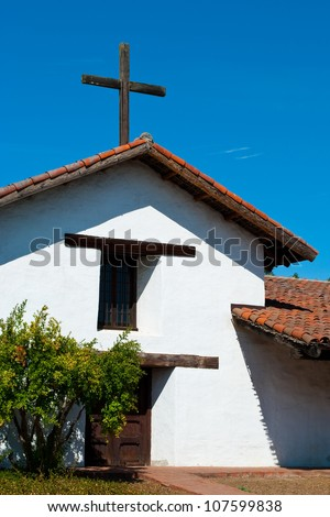 Spanish style church with rustic wooden cross