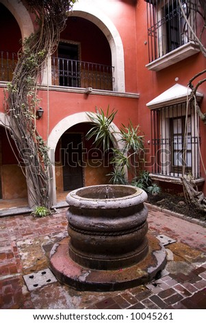 Spanish Style Courtyard and Well Morelia Mexico - stock photo