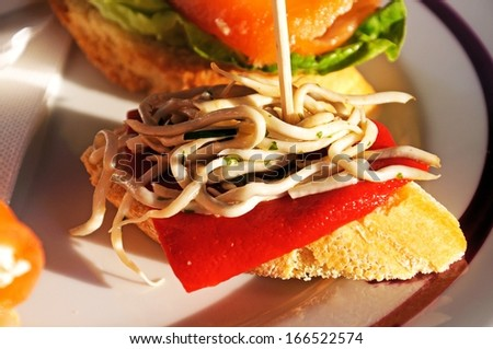 Spanish Tapas of white fish noodles with red pepper, Marbella, Costa del Sol, Malaga Province, Andalucia, Spain, Western Europe. - stock photo