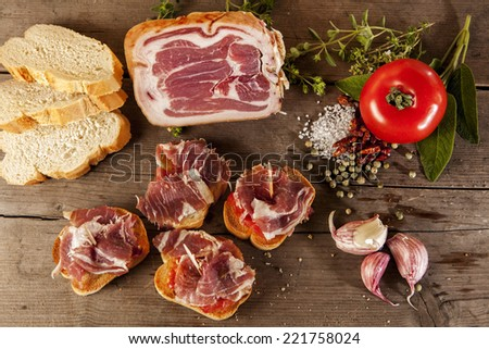 Spanish tapas presented on a wooden floor - stock photo