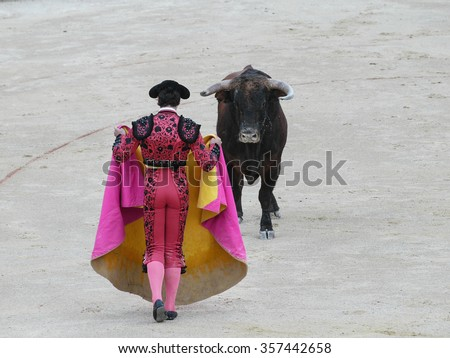 Spanish torero matador bullfighter performing a traditional classic bullfight at a big arena Spain - stock photo
