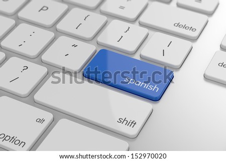 Spanish translation button on keyboard with soft focus  - stock photo