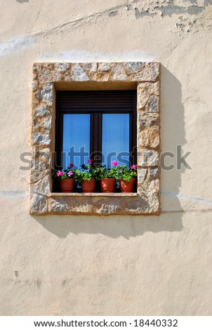 Spanish window with geraniums
