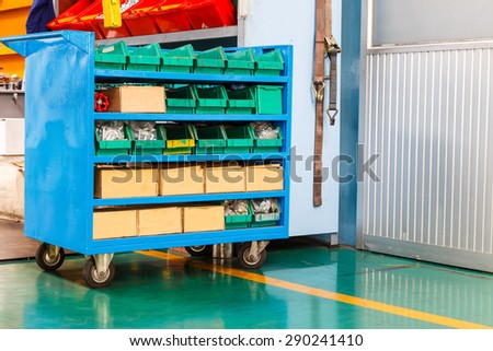 Spare part and tools cart in factory - stock photo
