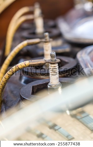 Spark plug in the old engine - stock photo