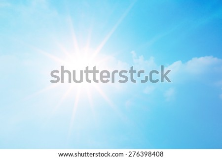 sparkle bright sun over clear blue sky - stock photo