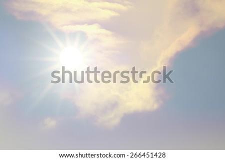 sparkle bright sun over fuzzy cloud - stock photo