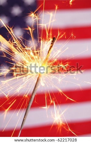sparkler and usa flag showing 4th of july - stock photo