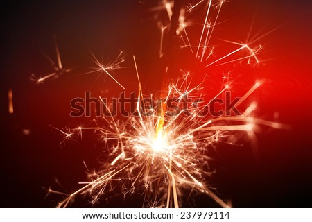 sparkler fire on red background - stock photo