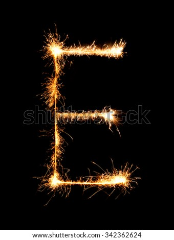 Sparkler firework light alphabet E (Capital Letters) at night background - stock photo