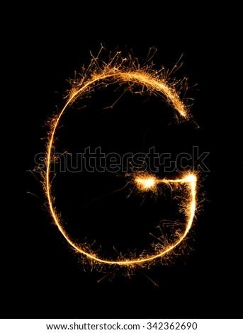 Sparkler firework light alphabet G (Capital Letters) at night background - stock photo