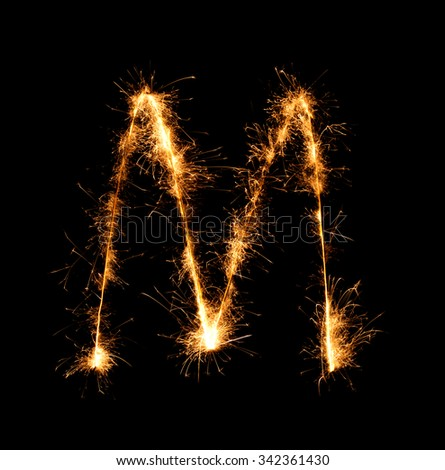 Sparkler firework light alphabet M (Capital Letters) at night background - stock photo