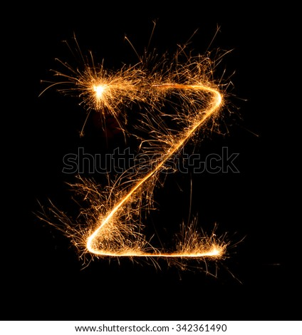 Sparkler firework light alphabet Z  at night background - stock photo