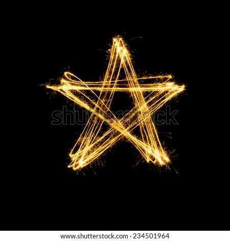 Sparkler firework light with star shape isolated on black background. - stock photo