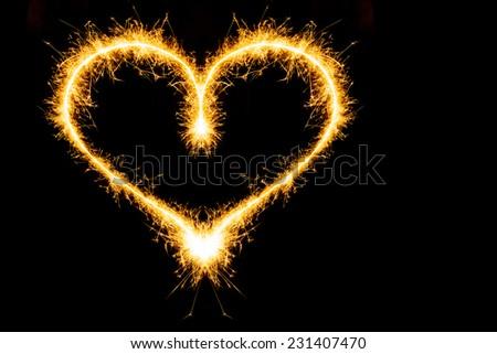 Sparkler heat heart. - stock photo