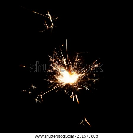 sparkler isolated on black background sparks - stock photo