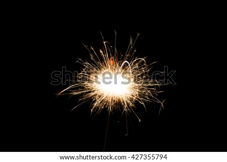 Sparkler on black background, close-up - stock photo