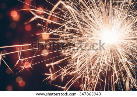 Sparkler on bokeh background - stock photo