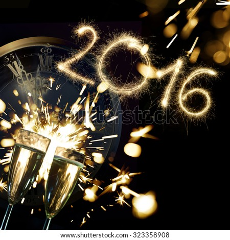 Sparkler 2016 with champagne glasses and countdown clock to midnight - stock photo