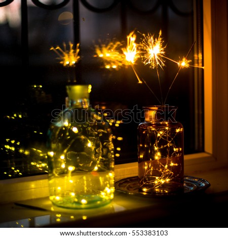Sparklers and Christmas lights in bottles and jars