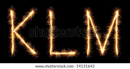 sparklers forming letters, K L M (see more letters in my portfolio)