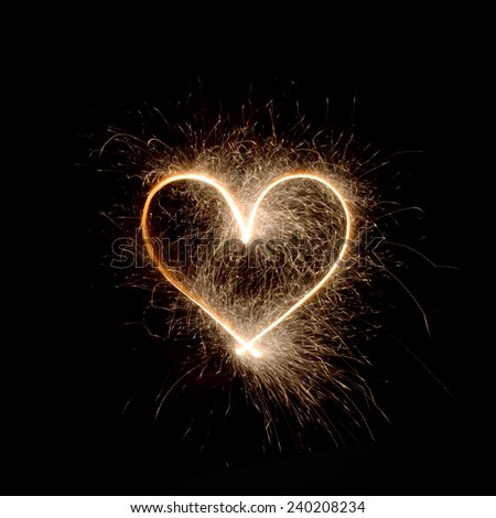 Sparklers heart, Using a camera with a slow shutter speed - stock photo