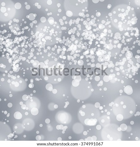 Sparkles, light on gray background. Abstract background, shine, bokeh.