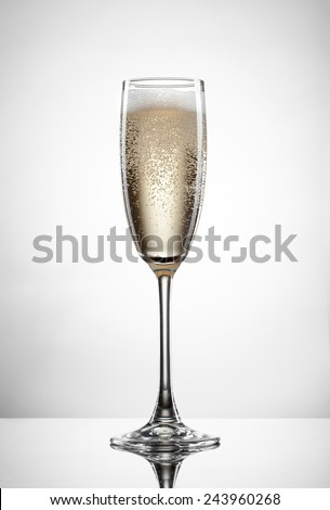 Sparkling champagne in glass isolated on white background - stock photo