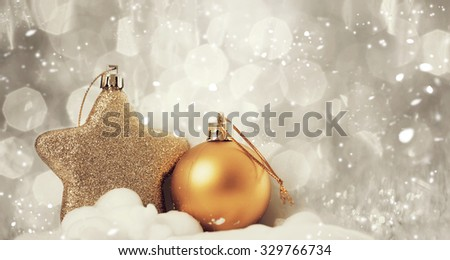 Sparkling Christmas background with golden Christmas decorations - stock photo
