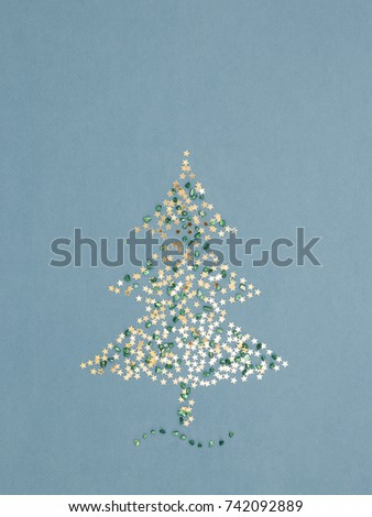 Sparkling christmas tree made gold stars stock photo 742092889 sparkling christmas tree made of gold stars sequins and green shiny pebbles on blue holiday m4hsunfo