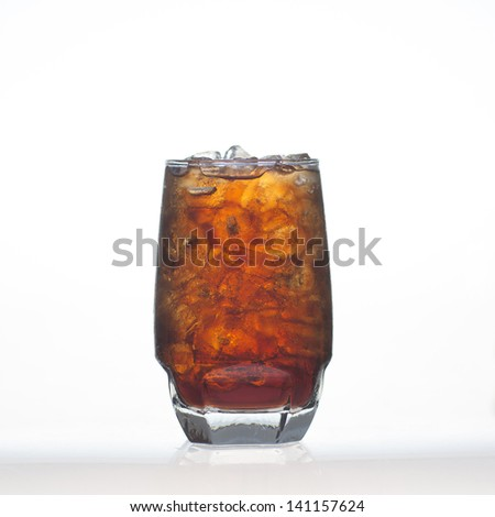 Sparkling cola soft drinks whit soda water and ice in glass isolated on white background - stock photo