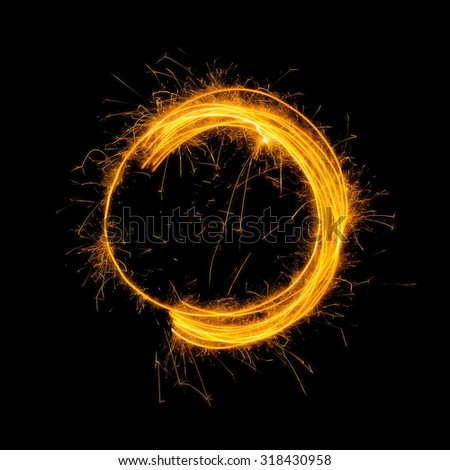 Sparkling Glowing Fire Circle on Black Background  - stock photo