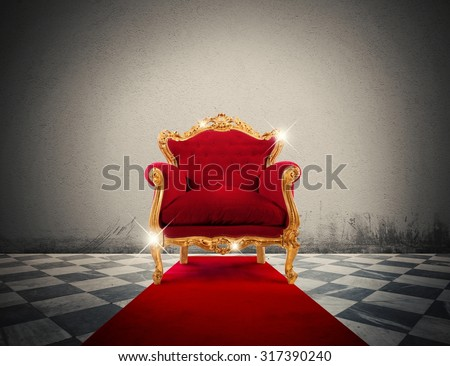 Sparkling golden armchair in a red carpet - stock photo