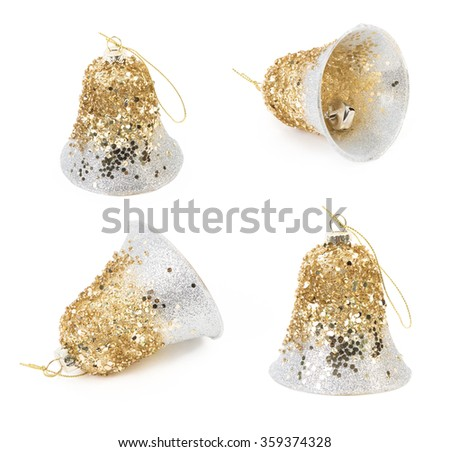Sparkling holiday bell christmas toy shot on white background - stock photo