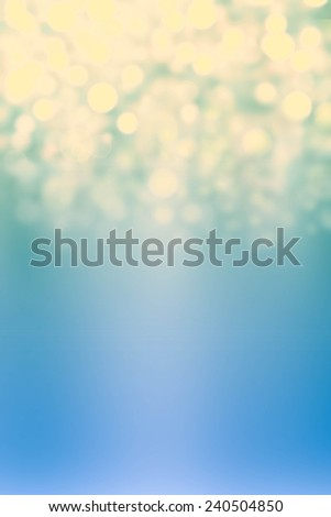 Sparkling Lights Festive background with texture. Abstract Christmas twinkled bright background with bokeh defocused silver and golden lights