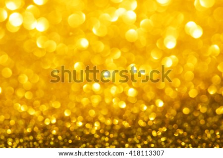 Sparkling or shimmering gold background. Intense sparkle. Good christmas and gift season background. Soft focus.