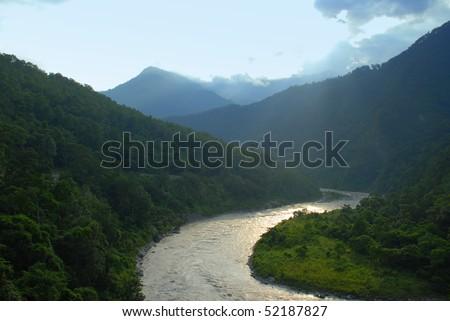 sparkling river on a darjeeling tea estate - stock photo