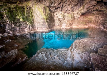 Sparkling turquoise blue water of the Grotto at Bruce Peninsula National Park, Tobermory Ontario, Canada