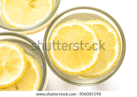 Sparkling water glass with lemon, view from the top