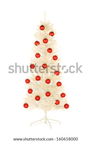 Sparkling white artificial Christmas tree with red balls isolated on white - stock photo